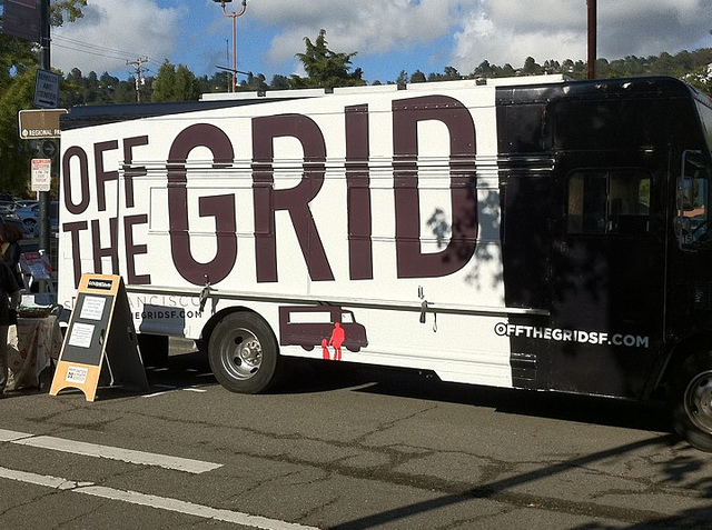 "bus with ""off the grid"" painted on the side"