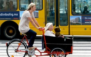 A mother, child, and grandmother all bike together in Copenhagen, Denmark. Photo by Mikael Colville-Andersen.