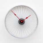 An upcycled Bike Wheel Clock by pixelthis via Etsy.